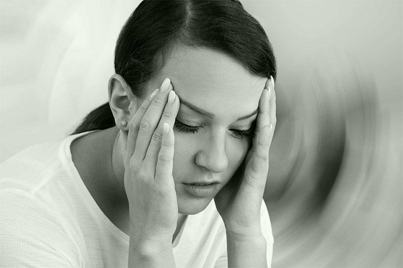 Women dizzy holding head